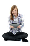 Smartly dressed teenager surfing on tablet pc Stock Photos