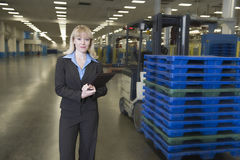 Smartly Dressed Woman In Newspaper Factory Royalty Free Stock Photo