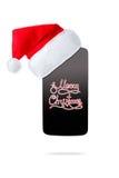 Smartphon dans le chapeau de Noël D'isolement sur le fond blanc photo stock