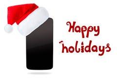 Smartphon dans le chapeau de Noël D'isolement sur le fond blanc image libre de droits