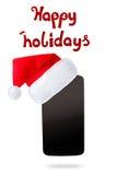 Smartphon no chapéu do Natal Isolado no fundo branco Foto de Stock Royalty Free