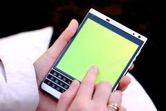 Smartphone à disposição, exposição do toque Fotografia de Stock