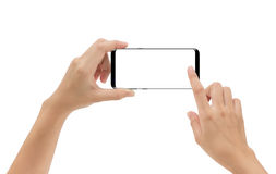Smartphone εκμετάλλευσης χεριών κινητό και σχετικά με την οθόνη που απομονώνεται Στοκ Εικόνες