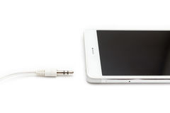 Smartphone και ακουστικό καλώδιο που αποσυνδέονται Στοκ φωτογραφία με δικαίωμα ελεύθερης χρήσης