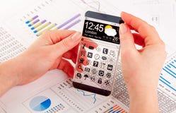 Smartphone με τη διαφανή οθόνη στα ανθρώπινα χέρια Στοκ Εικόνες