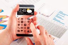 Smartphone με τη διαφανή οθόνη στα ανθρώπινα χέρια Στοκ Φωτογραφία