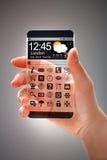 Smartphone με τη διαφανή οθόνη στα ανθρώπινα χέρια Στοκ Εικόνα