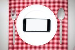 Smartphone στο πιάτο Στοκ εικόνα με δικαίωμα ελεύθερης χρήσης