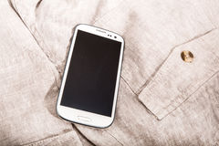 Smartphone στο ύφασμα Στοκ Εικόνες