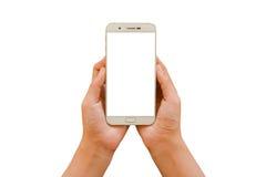 Smartphone владением 2 рук Стоковые Фотографии RF