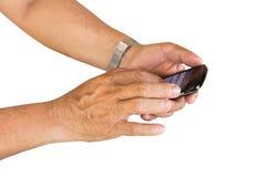 Smartphone игры руки на изолированной белизне Стоковое Изображение