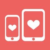 Smartphone и таблетка с значком вектора сердца Стоковое Изображение