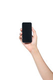 Smartphone на женской изолированной руке Стоковые Изображения RF