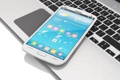 Smartphone на клавиатуре компьтер-книжки Стоковые Фото
