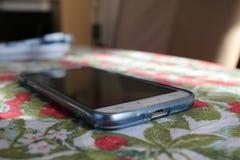 Smartphone на таблице Стоковая Фотография RF