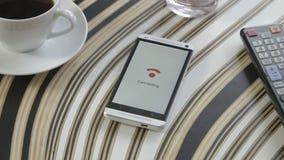 Smartphone подключая к WiFi видеоматериал