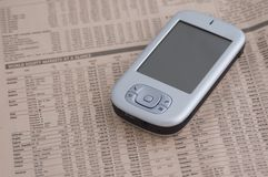 Smartphone 1. Smartphone on a financial newspaper royalty free stock photos