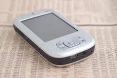 Smartphone 2. Smartphone on a financial newspaper Royalty Free Stock Photography