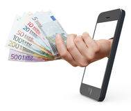 与smartphone的移动付款 库存图片