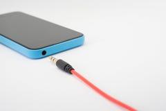 Γρύλος ακουστικών στο smartphone Στοκ εικόνες με δικαίωμα ελεύθερης χρήσης