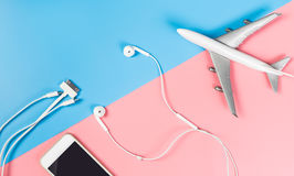 Smartphone accessories for traveling on the plane on blue and pink Stock Photography