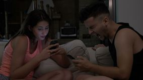 Smartphone addiction with married couple with communication problems chatting on their smartphone stock video