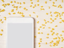 Smartphone, alphabet noodles, cooking app Stock Images