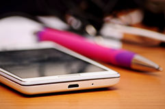 Smartphone And Pen Royalty Free Stock Photos