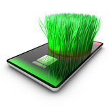 A smartphone application is growing grass. Ecological concept Royalty Free Stock Photography
