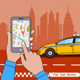 The smartphone with the application of services of a city taxi on ekrane. Royalty Free Stock Images