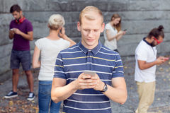 Smartphone as a communicator. Group of young people using smartphone as a communicator with friends stock image