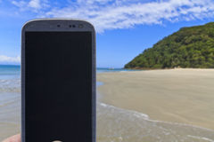 Smartphone at As ilhas in Barra do Sahy Royalty Free Stock Photography