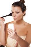 Smartphone as a mirror Stock Photo