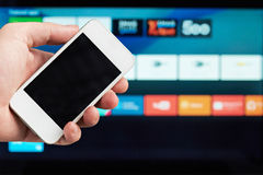 Smartphone as tv control Stock Images