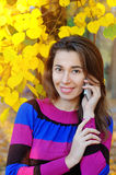 Smartphone Autumn woman talking on mobile phone in fall Royalty Free Stock Images