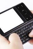 Smartphone avec des chemins de découpage Photographie stock libre de droits