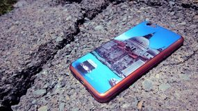Smartphone Back Cover With Very Beautiful Wallpaper. Shot on cement brick Stock Photo