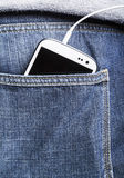 Smartphone in back pocket Royalty Free Stock Photos