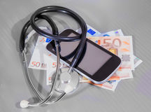 smartphone of banknote of euro and stethoscope Royalty Free Stock Photos