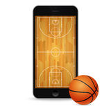 Smartphone with basketball ball and court on the screen. Royalty Free Stock Photo