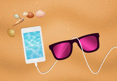 Smartphone on the beach Royalty Free Stock Images