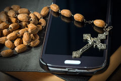 Smartphone Bible Crucifix and Rosary Beads Royalty Free Stock Photos