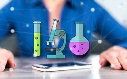 Concept of biotechnology. Smartphone with biotechnology concept between hands of a woman in background stock illustration