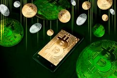 Smartphone with Bitcoin symbol on-screen among piles of golden and silver Bitcoins on green Stock Image