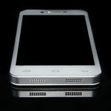 Smartphone. On the black glass with a focus on the front panel Stock Photography