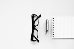 Smartphone and black glasses. Isolated on white. Sepia. Stock Photo