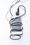 Smartphone with black and white jack plug on background Stock Image