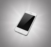 Smartphone blanc d'isolement sur un fond gris Photographie stock libre de droits