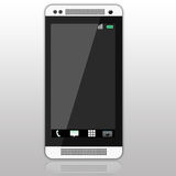 Smartphone blanco y negro clásico en un fondo gris de la pendiente Imágenes de archivo libres de regalías