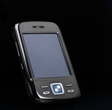 Smartphone with blank screen on black background Stock Images